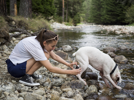 Young traveler capturing fun moments with her dog