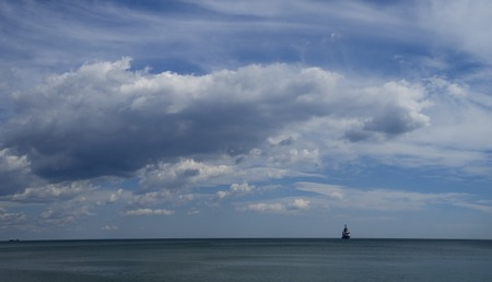 Panorama of a lone ship in the sea. Seascape.