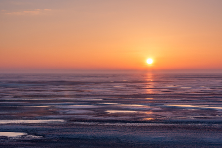 sea sky: Spectacular sunset over frozen Puck Bay in Poland