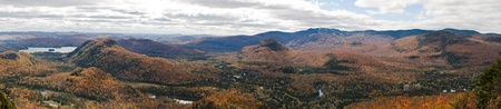Panoramic view of mountains during Fall with colorful trees