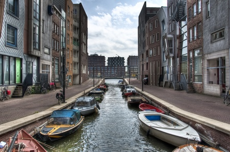 suburban: Suburban region of the city of Amsterdam with a beautyful and calm canal Stock Photo