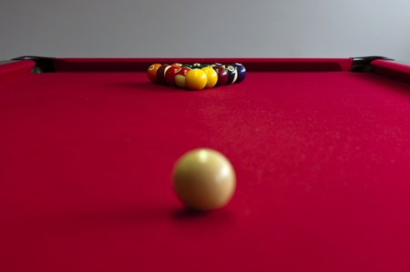 A red pool table ready to play