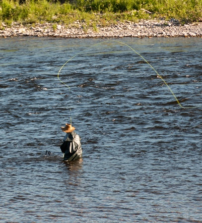 Man using the fly fishing technique photo