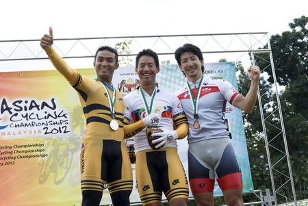 keirin: KUALA LUMPUR, MALAYSIA - FEBRUARY 12, 2012: Winner of Keirin category, from left Azizulhasni Awang(MAS) silver medal, Josiah Ng(MAS) gold medal and Kazunari Watanabe(JPN) bronze medal during 32nd Asian Cycling Championships 2012. Editorial