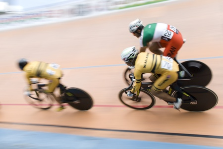 keirin: KUALA LUMPUR, MALAYSIA - FEBRUARY 12, 2012: Cyclist race during final keirin category in 32nd Asian Cycling Championships 2012. From left, Josiah NG(MAS), Azizulhasni Awang(MAS) and Mohammad Parash(IRI).