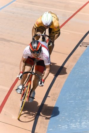 KUALA LUMPUR - FEBRUARY 10: Cyclist from Japan (front) competed with riders from Malaysia (rear) during the Asian Cycling Championships in 2012 in Kuala Lumpur, Malaysia on Friday, February 10, 2012.  Editorial