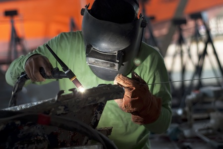 skilled labour: Welder Boat  Stock Photo