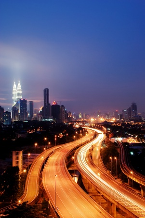 Stunning light trail scenery at the busy highway in Kuala Lumpur city at night  Фото со стока