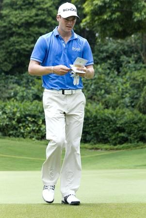 KUALA LUMPUR, MALAYSIA - APRIL 12: Martin Kaymer of Germany writing at his scorecard during 1st round of Maybank Malaysian Open 2012 at Kuala Lumpur Golf & Country Club on Thursday, April 12, 2012