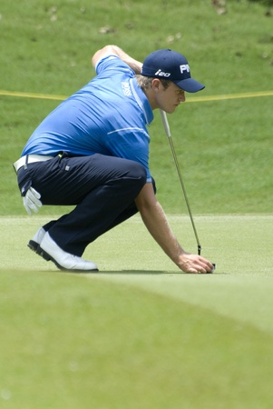 KUALA LUMPUR, MALAYSIA - APRIL 12: Tom Lewis of England lines up hi putt in the 2nd green during Maybank Malaysian Open 2012 at Kuala Lumpur Golf & Country Club on Thursday, April 12, 2012