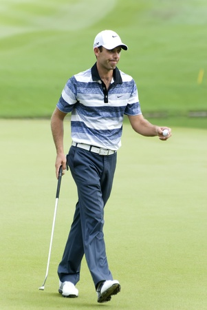 KUALA LUMPUR, MALAYSIA - APRIL 12: Charl Schwartzel of South Africa after make his putt in the 12th green during 1st round of Maybank Malaysian Open 2012 at Kuala Lumpur Golf & Country Club on Thursday, April 12, 2012 Stock Photo - 13257924