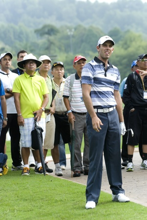 KUALA LUMPUR, MALAYSIA - APRIL 12: Charl Schwartzel of South Africa watching his ball after hits shot in the 13th holes during 1st round of Maybank Malaysian Open 2012 at Kuala Lumpur Golf & Country Club on Thursday, April 12, 2012