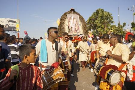 godliness: KUALA LUMPUR - JAN 27: Traditional Tamil music player accompanying the Kavadi bearer during Thaipusam festival at Batu Cave, near Kuala Lumpur, Malaysia on Sunday, January 27, 2013.  Editorial