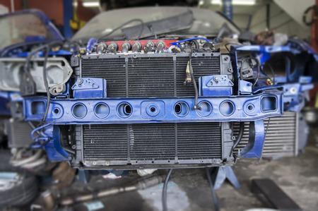 Close up view engine radiator at workshop
