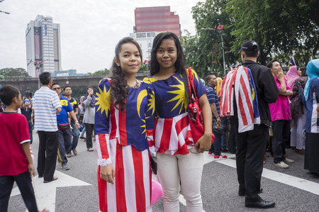 KUALA LUMPUR, MALAYSIA - AUGUST 31: Unidentified young girl wearing Malaysia national flag dress during celebration of Independence Day 57th in Merdeka square, Kuala Lumpur, Malaysia on August 31, 2014