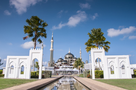 islamic scenery: Crystal mosque on sunny day with blue sky and clouds