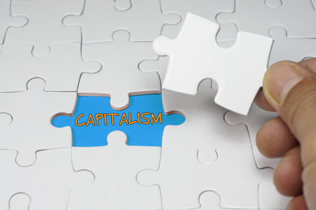 capitalism: Word puzzle of Capitalism - Business Concept Stock Photo