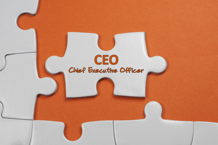 motivator: Chief Executive Officer word on white puzzle - Business Concept Stock Photo