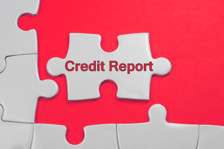 repay: Credit Report on white puzzle - Business Concept Stock Photo
