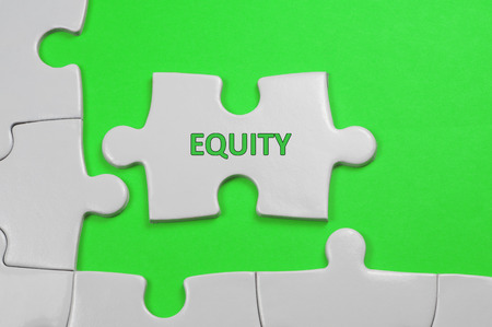 equity: Equity word on white puzzle - Business Concept
