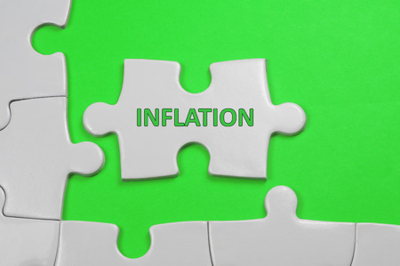 monetary devaluation: Inflation word on white puzzle - Business Concept