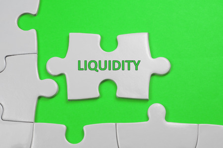 Liquidity word on white puzzle - Business Concept