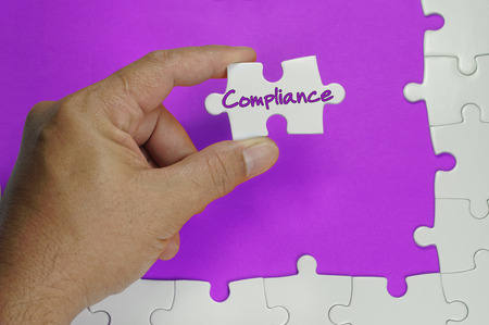 compliant: Compliance word on white puzzle - Business Concept