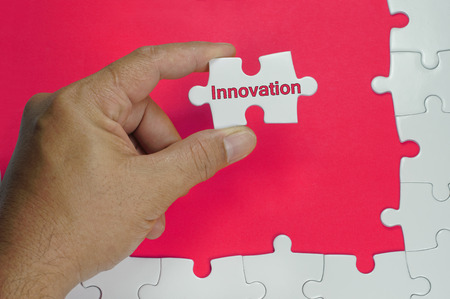 innovation word: Innovation Word on white puzzle - Business Concepts
