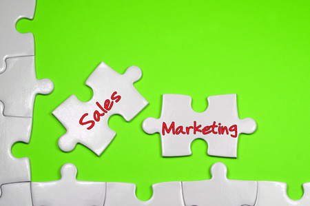 pr: Sales Marketing word on white puzzle - Business Concept
