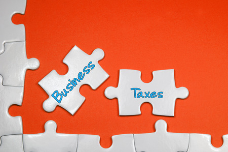 levied: Business Taxes word on white puzzle - Business Concept