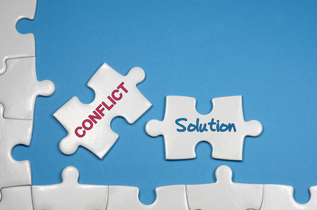 resolution: Conflict and Solution word on white puzzle - Business Concept