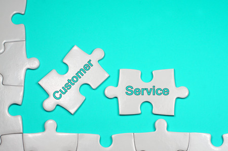 responded: Customer Service word on white puzzle - Business Concept Stock Photo