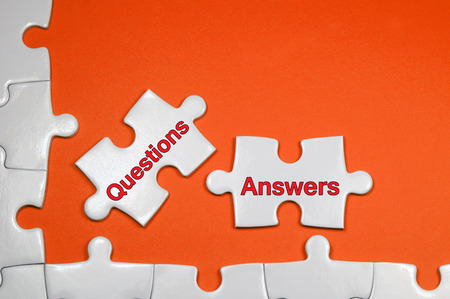 Questions and Answers word on white puzzle - Business Concept photo