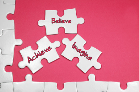 achiever: Achieve Believe Imagine word on white puzzle - Business Concept