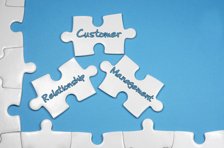 responded: Customer Relationship Management word on white puzzle - Business Concept