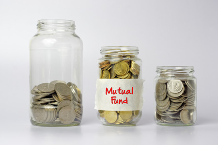mutual fund: Three different size of jars with Mutual fund text - Financial Concept