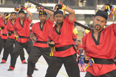 merdeka: KUALA LUMPUR, MALAYSIA - AUGUST 31: Member of pencak silat from Malaysia Military Force demonstrating martial art during celebration of Malaysia Independence day 58th in Merdeka square, Kuala Lumpur, Malaysia on August 31, 2015