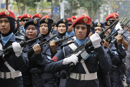 personel: KUALA LUMPUR, MALAYSIA - AUGUST 31: Unidentified Malaysian Navy personel during parade celebration of Malaysia Independence day 58th in Merdeka square, Kuala Lumpur, Malaysia on August 31, 2015