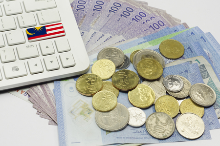 Malaysia flag on the keyboard surrounding by Malaysian currency