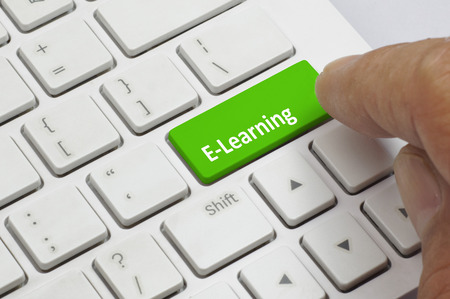 detail internet computer: Finger pushing the green button of keyboard with E- Learning word - Business Concept