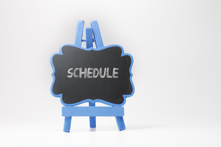 Schedule  text on blackboard isolated on white background Banque d'images