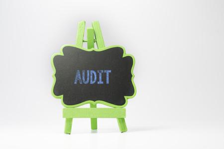 governing: Audit text on blackboard isolated on white background