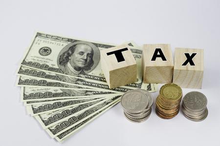 wooden block: Tax Concept text on wooden block