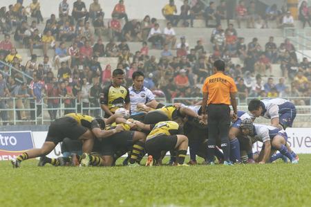 scrum: KELANA JAYA, SELANGOR - OCT: Perak rugby palyer(yellow) and Sabah rugby player scrum during match final Agong Cup. Sabah defeated Perak with score Sabah 28 - Perak 16, in Kelana Jaya, Malaysia on October 3rd, 2015