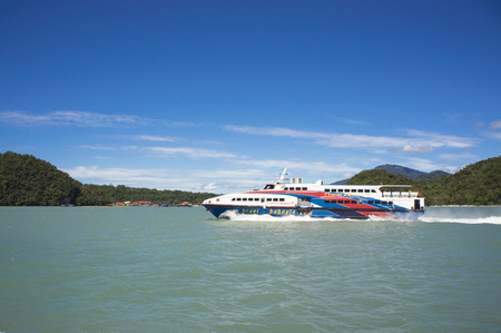 approached: LANGKAWI ISLAND, MALAYSIA - NOVEMBER 28: Ferry from Kuala Kedah approached to Langkawi island, Malaysia on November 28, 2015.