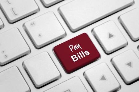 pay bills: Pay Bills word written on white keyboard