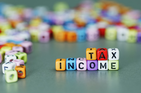 increment: Income Tax word on colorfull dices