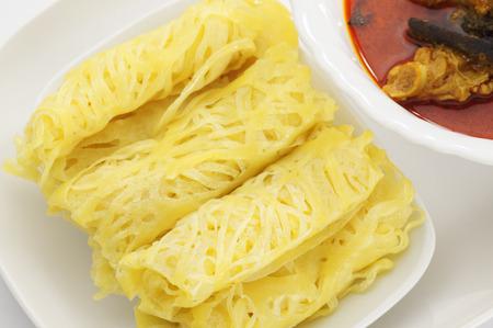 malaysian food: Roti Jala and Chicken Curry, traditional Malaysian Food