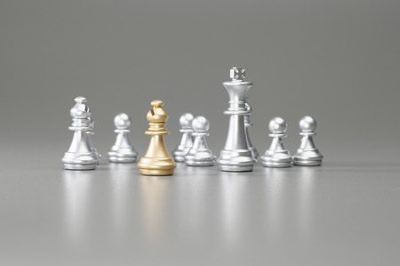 pawn king: Golden Bishop with silver king, rook, pawn on the background Stock Photo