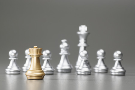 pawn to king: Golden Rook with silver king, bishop, pawn on the background